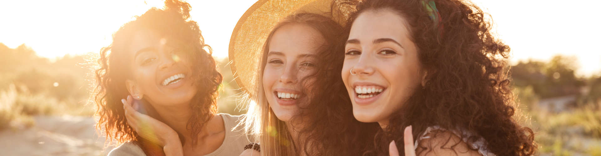 Young caucasian and african american women 20s in stylish clothing laughing during summertime.