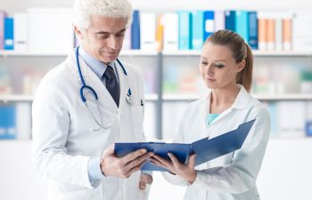 Doctor Reviewing Medical Records